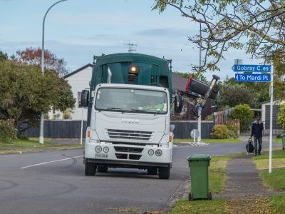 Bin being lifted by truck